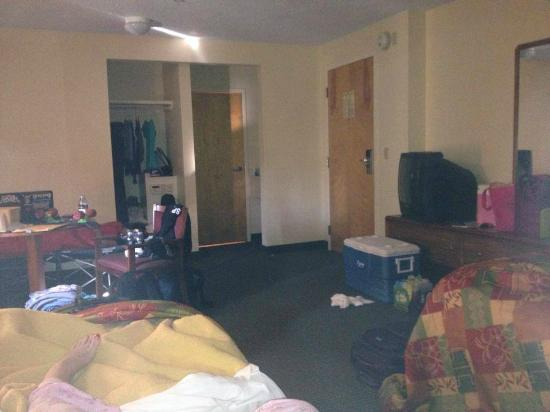 Budget Host Inn: Our huge room (sorry about the mess)