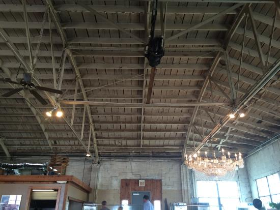 B & C Bbq: The famous chandelier and garage ceiling overhead ... Cello music playing in the background...