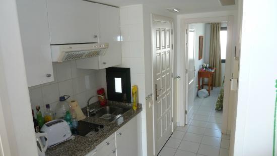 Erika Apartments Kitchen Area And Main Entrance