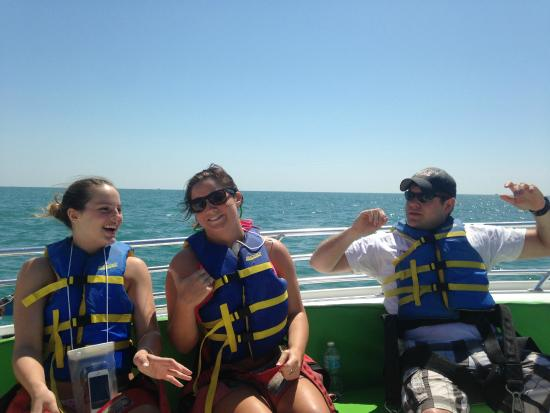 Eagle Parasail: Three young folks lookingo forward to the ride!