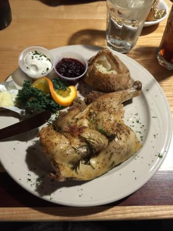 Judi's Restaurant & Lounge: Roasted Rosemary half-chicken paired with a baked potato