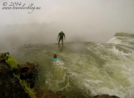 Livingstone, Zambia: Taking the plunge - our guide was there to catch us at the other side!