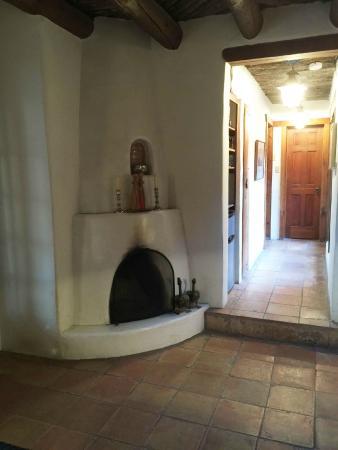 Dunshee's Casita: kiva fireplace in living room