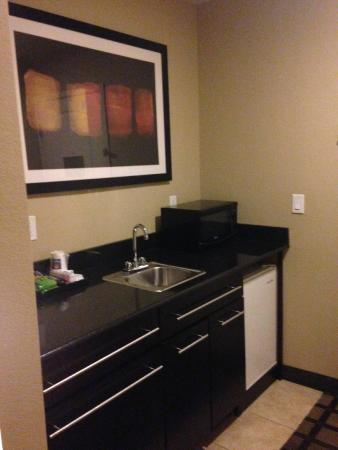 Comfort Inn & Suites - Fort Smith : Mini fridge, sink, cabinets and coffee pot right as you enter the room