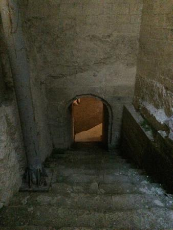 One of the many narrow, steep stairwells at Palais des Papes.