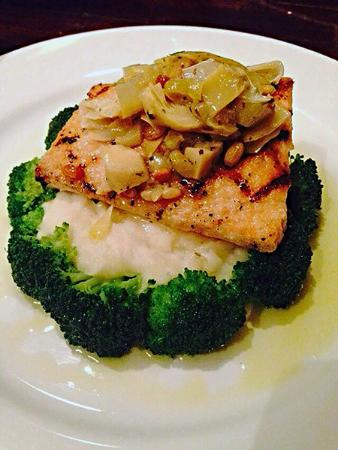 The James: Salmon over a bed of mashed potatoes and broccoli...