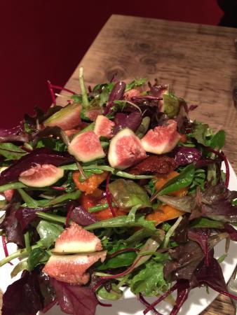 Fresh bowl of Rocket Salad with fresh figs. Vegan heaven