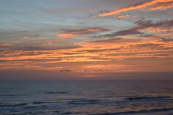 Seabreeze Beach Resort: Amazing sunrise view from condo balcony.