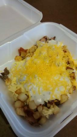 J Creek Cafe: My version of a breakfast bowl. Homefries, onions, peppers, bacon, ham topped with gravy and che