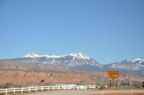 Spanish Trail RV Park: The snow capped laSal Mountains beyond the red rock cliffs, seen from the RV park.