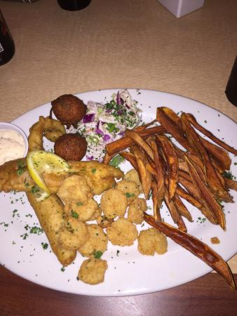Rockport, TX: Fish, shrimp, homemade sweet potaor fries, hush puppies and cole slaw! It was great! A local rec