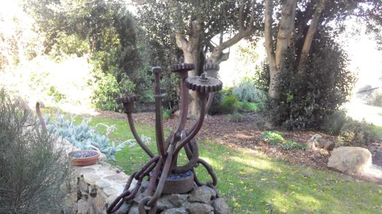 Seaview Farm : some if the rustic old farm equipment now a sculture in the lovely gardens