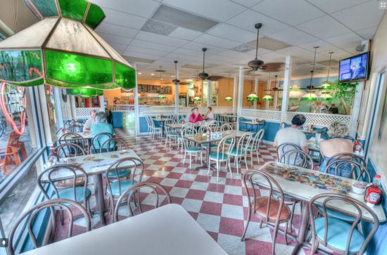 Truly Scrumptious Ice Cream Cafe : Step inside we have a table for you.