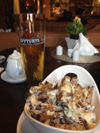 Priekule, Lituania: Fried bread with cheese sauce