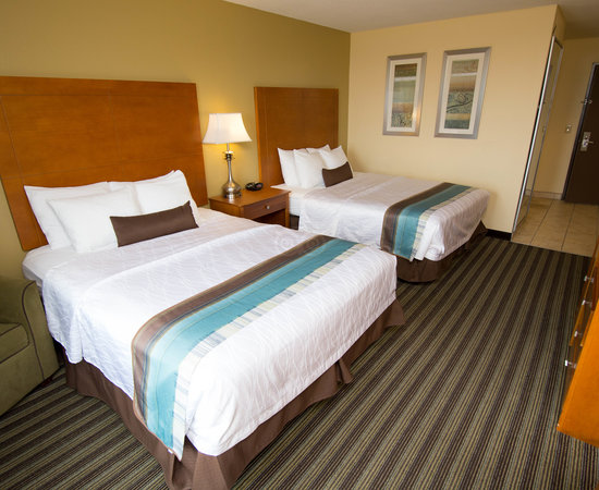 The Double Queen Room at the BEST WESTERN PLUS Seawall Inn & Suites by the Beach