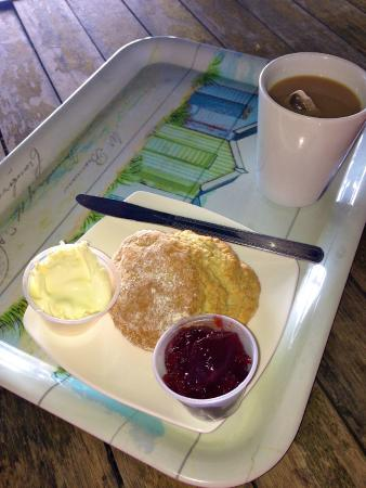 Seaton Beach Cafe: Scone and plastic tubs.
