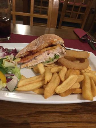 Restaurant at Harry's Aberystwyth: The chicken sandwich with salad, fries, and onion rings.