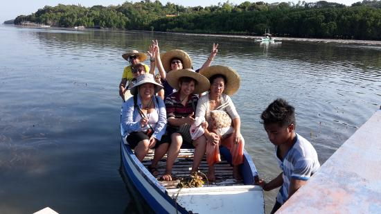San Jose, Philippines: These are missionaries on a row boat approaching Ilin Proper Village.