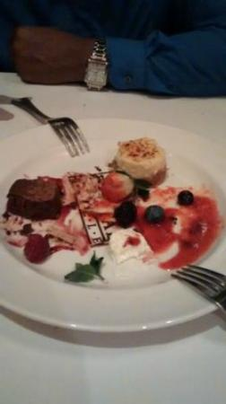 The Capital Grille: Desert trio half way through, the flourless chocolate cake tasted like truffles!
