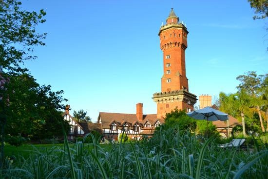Hotel L'Auberge: Famous old water tower, now with rooms inside, view from garden