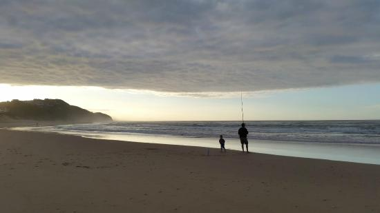 Myoli Beach Lodge: Dad and son fishing on the beach at sunrise