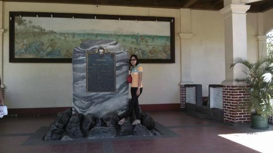commemorative marker mural painting on the wall depicting the