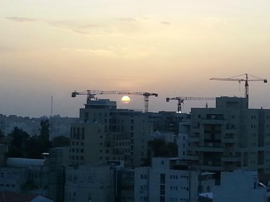 Windows of Jerusalem Vacation Apartments by EXP: Sunrise from Living room