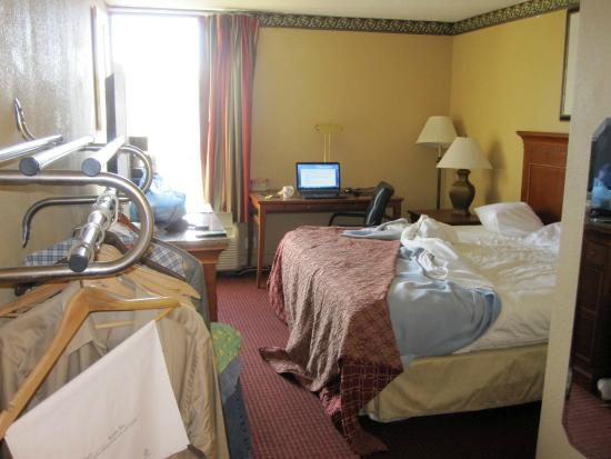 Super 8 Myrtle Beach/Market Common Area : Small room, tight squeeze between dresser & bed.