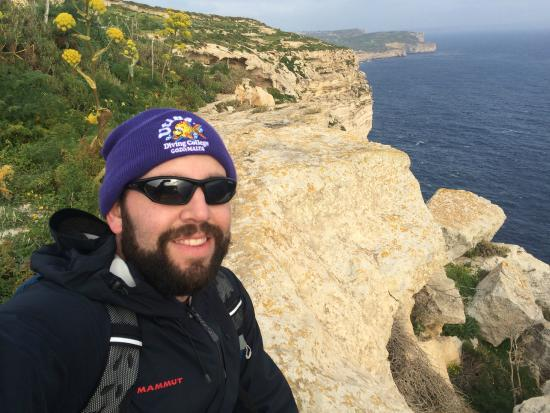 Cliffs of San Lawrenz and Dwejra: Sitting atop of San Lawrenz cliffs [view towards Kercem/Xlendi]