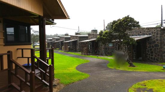 Kilauea Volcano Military Camp: KMC cottages, one bedroom (stone) and two bedroom on left (wood)