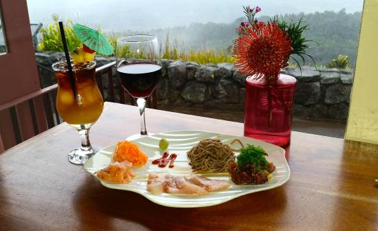 Kilauea Volcano Military Camp: A plate of Sashimi and drinks at nearby Volcano House restaurant overlooking Kilauea crater.