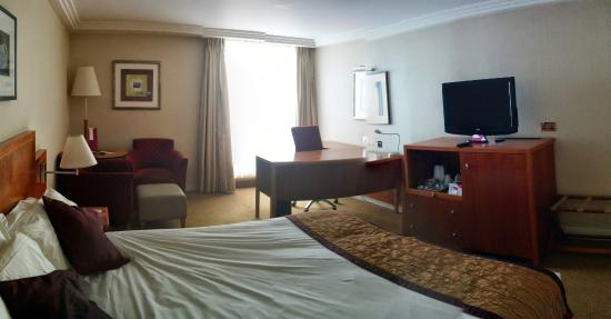 Large room including bed and desk