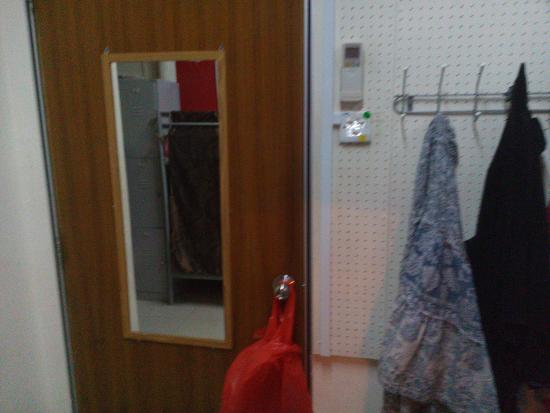 Hostel Century Service World: door has a mirror and hooks for towels or jackets etc