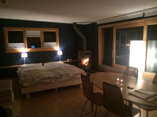 Hotel Edelweiss Davos Room With Fireplace And Dining Table