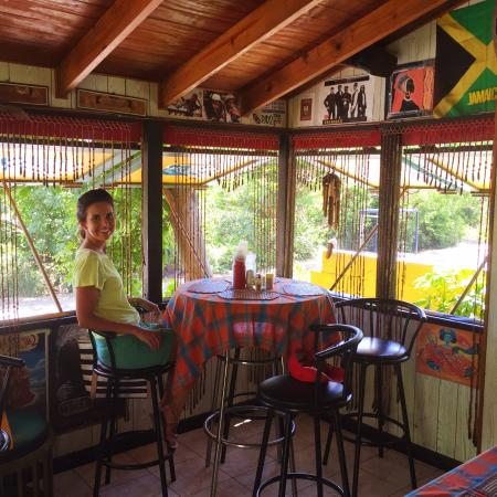 Freedom Fighters Ital Shack: Inside it's breezy and clean. That's the sorrel juice in the dark bottle on the table.