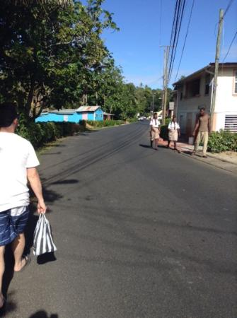 Calibishie Lodges: walking to the hotel after picking up rum at the market
