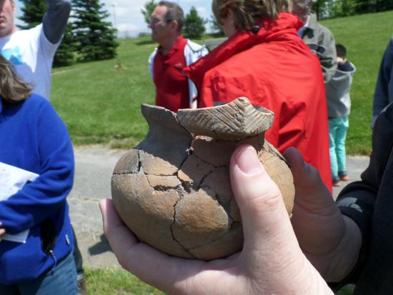 Heritage Toronto Tours: Tour leader showing a pot he dug up on a dig near this part of the tour.