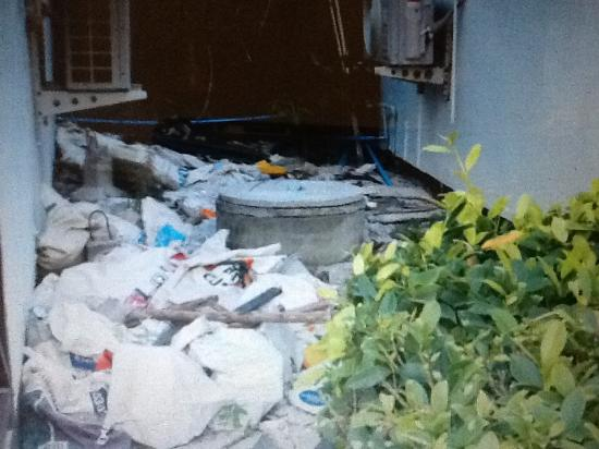Phi Phi Andaman Legacy: Rubbish dumped between the bungalows