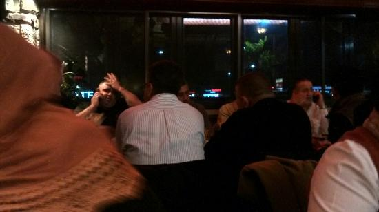 Al Bawadi Restaurant: The owner of the restaurant entertaining and eating with his own guests who arrived later than u