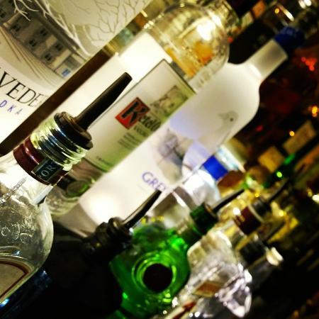 Champney's Restaurant & Tavern: Bottles on lighted shelf