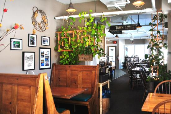 Blue Moon Cafe: The Sunlight Filled Dining Room, Decorated In Nature Themes,