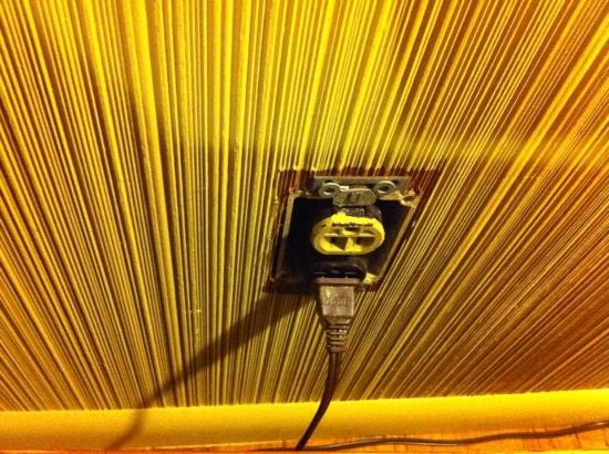 Inn of the Beachcomber: missing switch plate in living room