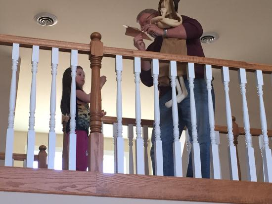 Denison, IA: Gary teaching our 4 year old how to fly paper airplanes from the balcony