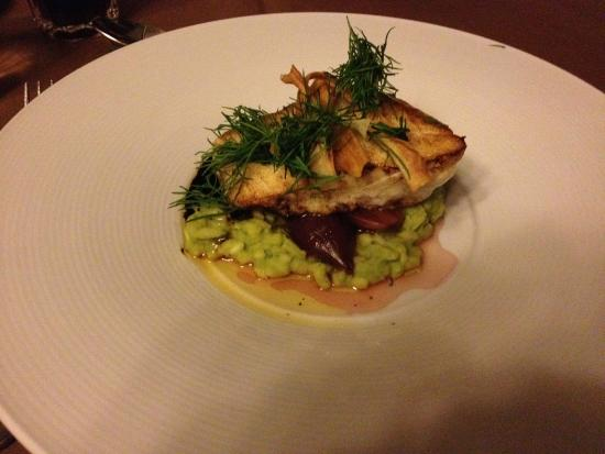 Funktionaermessen Restaurant: Fish on a bed of green risotto