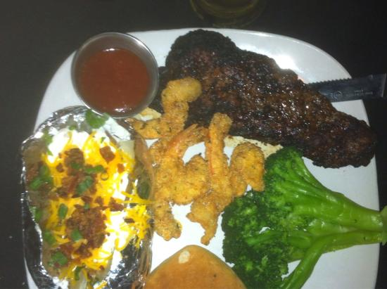 Memories & More Restaurant and Piano Bar: Steak and shrimp with baked potato and broccoli