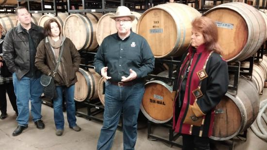 Bristol, PA: Owner gives tour, with large casks behind