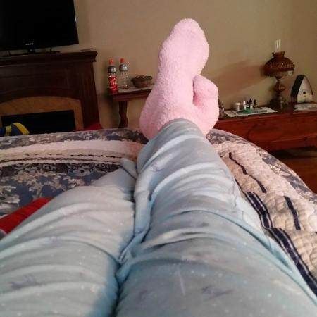 Captain's Castle and Carriage House Inn : Relaxing in fuzzy pink socks!