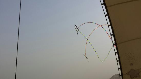Rizhao Beach Area: Synchronized Kite Flying