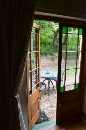 The Old Trading Post: Looking out from the guest lounge onto the patio