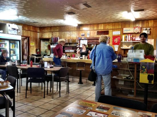 """Blanco Bowling Club Café: """"Coffee is a pleasure. Friends are a treasure"""" says the carved wood plaque on the wall."""